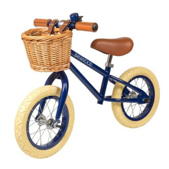 Bicicleta sin pedales, color azul marino.